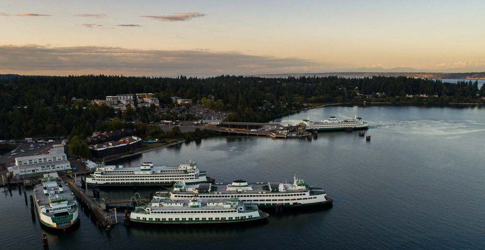 Aerial photo of ferries at Eagle Harbor after sunset.