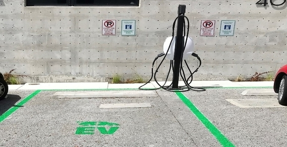 Electric car charging station and parking spaces