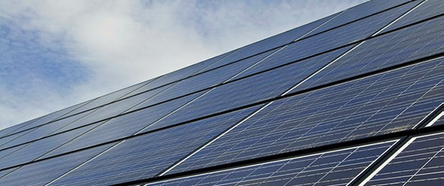 Solar panels reflect sunlight on a bright day.