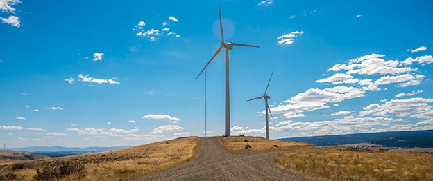 Wind turbines operate on a sunny day.